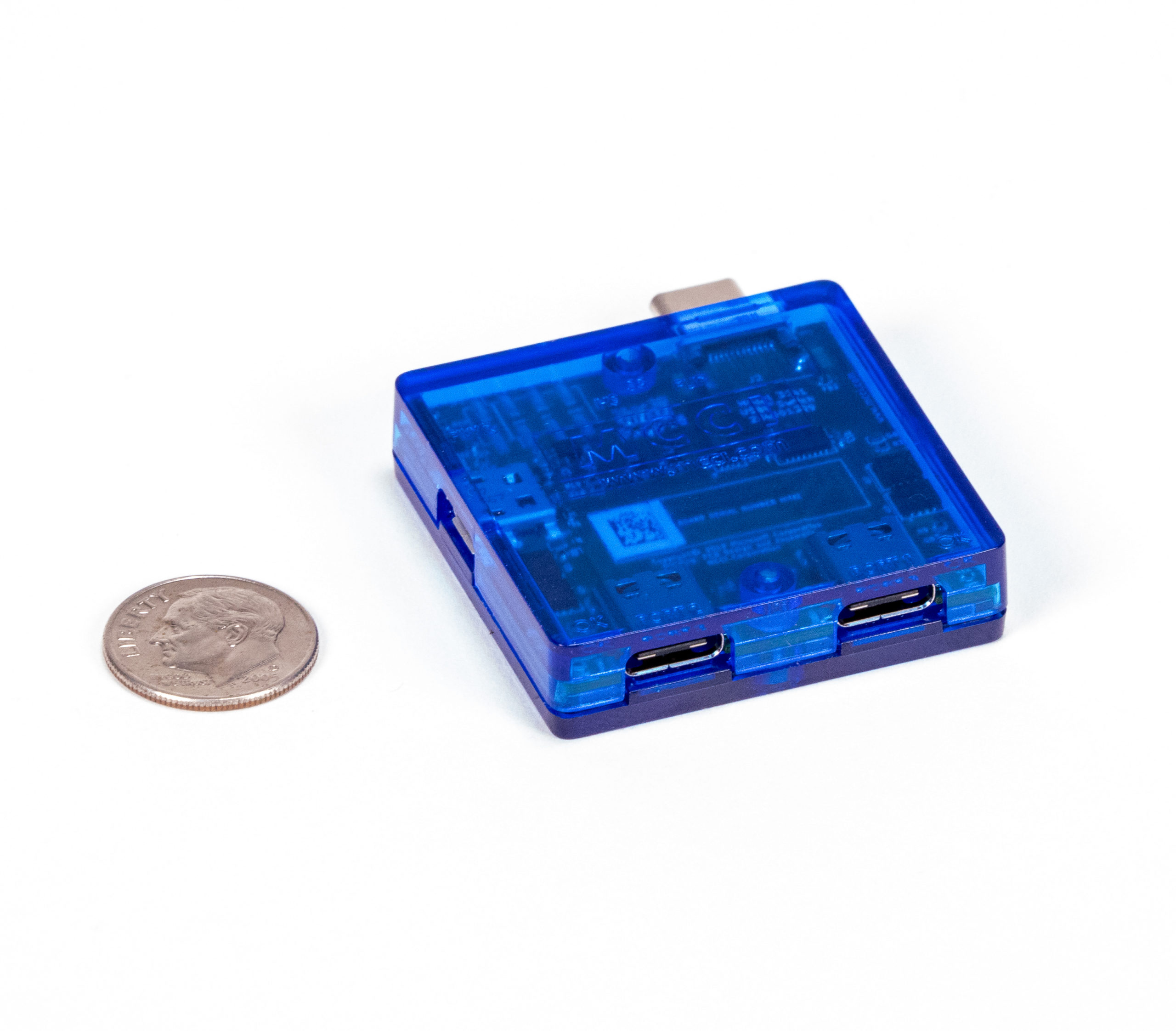 USB4 Switch in enclosure, wtih dime for scale